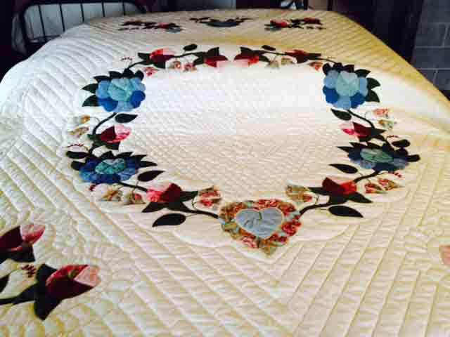 Hand appliqued and hand quilted.  A beauty.